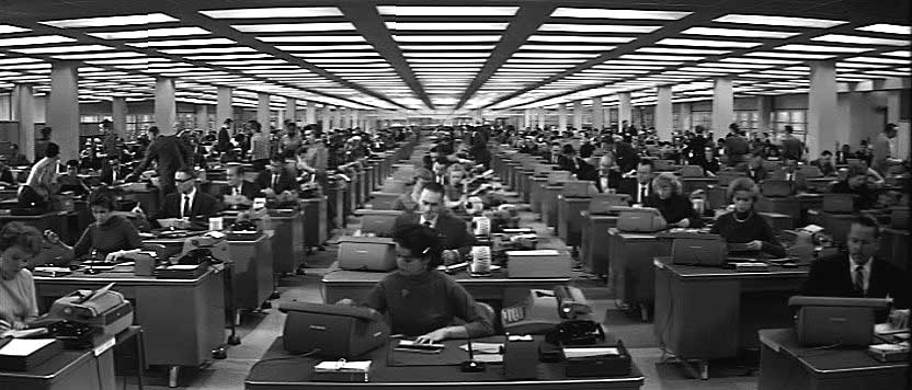 Desks and typewriters, as far as the eye can see